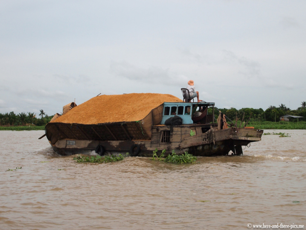 Rice husk on a boad on the Mekong,; Vietnam