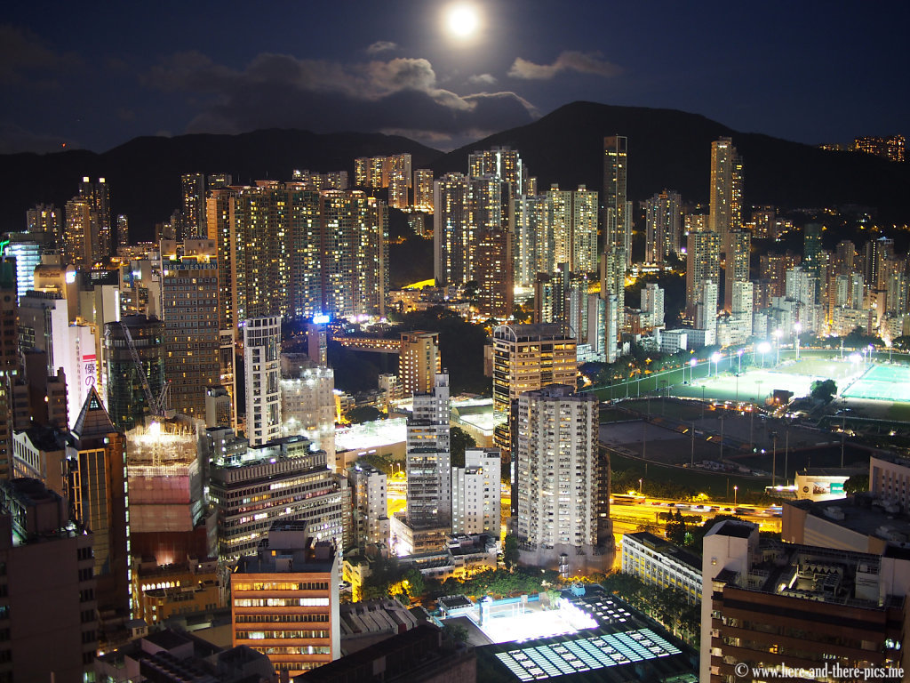 Full moon on buildings canopy in Hong Kong